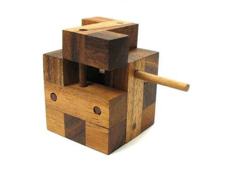 disjoint: Wooden cube puzzle. Isolated on white background. Contains Clipping Path.