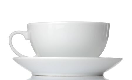White ceramic cup and saucer. on white isolated background. close-up.