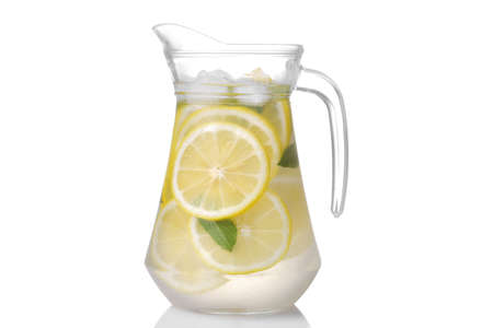 Homemade lemonade with mint and ice with a glass jug on a white background. isolated