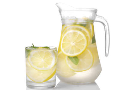 Homemade lemonade with mint and ice with a glass jug and a glass on a white background. isolated