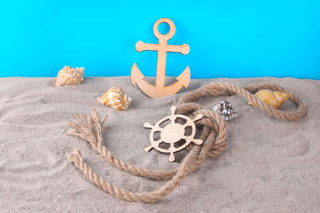 Marine attributes, Decorative steering wheel and steering wheel with seashells on a blue background