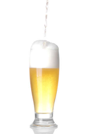 A light beer in a glass goblet on a white background. isolated