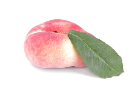 Large fresh figs of a peach with a green leaf on a white isolated background.