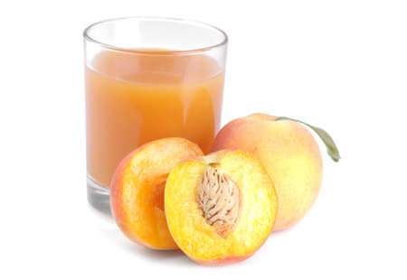 Large fresh peach with green leaf and peach halves and juice on white isolated background.
