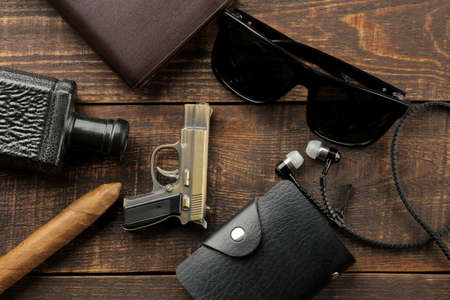 Men's Accessories. men's style. perfume, wallet, business card holder, glasses, cigar, on a brown wooden background. flat lay.