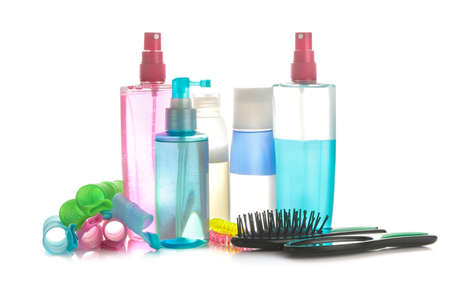 Various hair care products and various hair accessories on a white isolated background. hair cosmetics 免版税图像