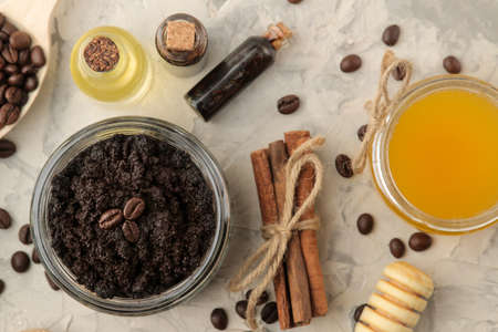 homemade coffee scrub in a jar for the face and body, and various ingredients for making scrub on a light background. spa. cosmetics. care cosmetics. view from above