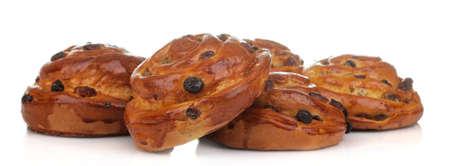 Tasty buns with raisins on a white isolated background. fresh bakery. close-up. Stockfoto