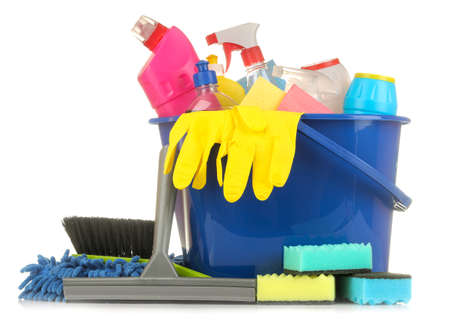 Bottles with cleaning products and detergents in a blue bucket on a white isolated background. cleaning. cleaning products