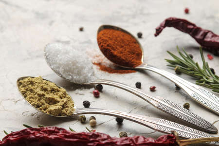 herbs and spices. various seasonings, herbs and spices on a light concrete background. 스톡 콘텐츠