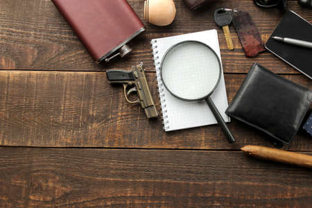 Men's Accessories. men's style. purse, flask, smoking pipe, perfume, business card holder, notebook, keys, glasses, cigar, on a brown wooden background. flat lay. Stock fotó