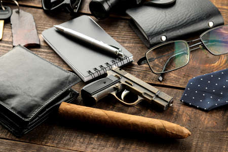 Men's Accessories. men's style. purse, flask, smoking pipe, perfume, business card holder, notebook, keys, glasses, cigar, on a brown wooden background. Stock fotó