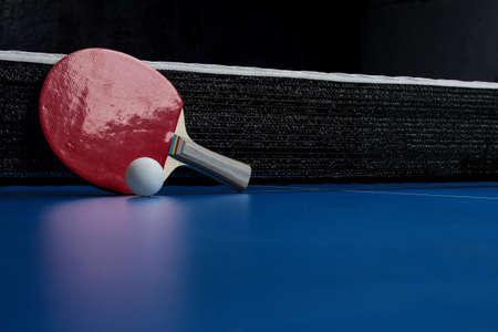 Two  table tennis rackets. Table tennis rackets and a ball on a blue tennis table Foto de archivo