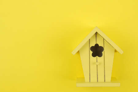 The concept of minimalism. decorative little yellow bastard on a bright yellow background. view from above. place for text