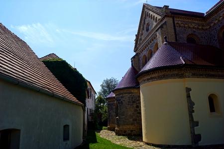 Church, house and grass - Hosin, South Bohemia