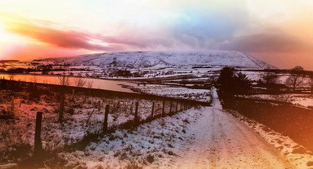 Red sunset at Pendle hill at the time of the beast from the east.