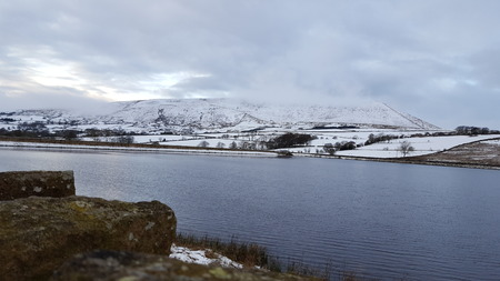 Pendle hill captured at reservoir. Stock Photo