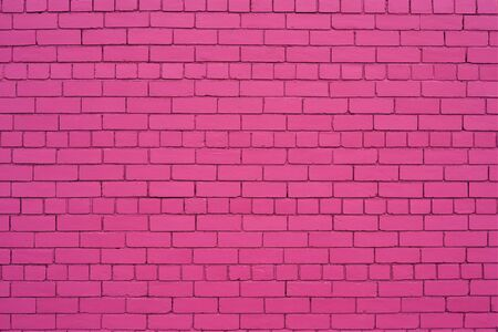 Pure pink painted brick wall.