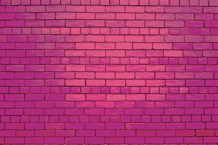Pink brick wall with deferent shades of pink. Stock Photo