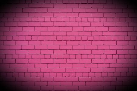 pink brick wall with vignette.