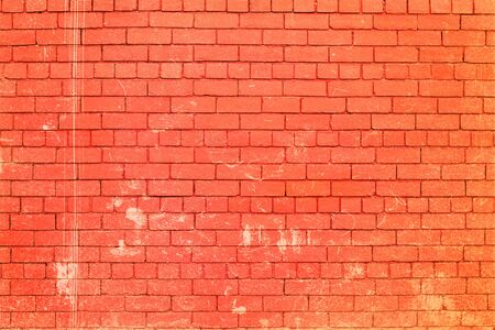 Painted brick wall with scratches.