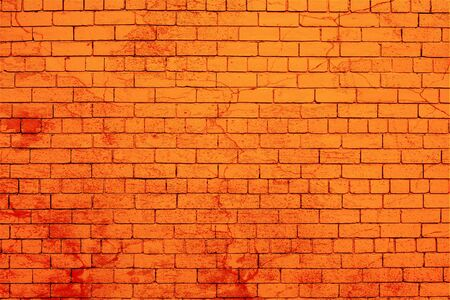 Red brick wall splashed with darker red paint.