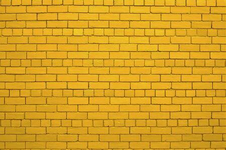 Capture of yellow (gold) brick wall. Stock Photo