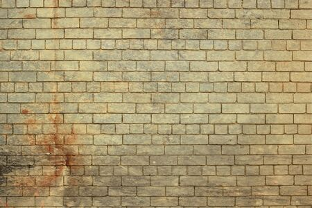 Rustic effect painted brick wall. Stock Photo