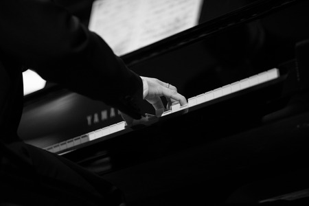comunication: Pianist playing piano during a concert of classical music Stock Photo