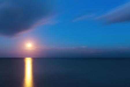 moon  metropolis: beach at night photo taken at slow shutter speeds moonlit sky Stock Photo