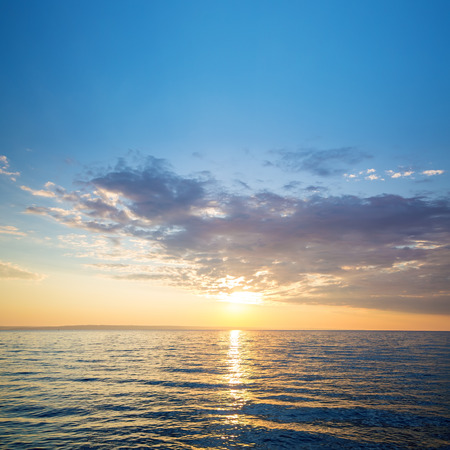 sunrise on the water  Early summer morning bright sky Beach Stock Photo
