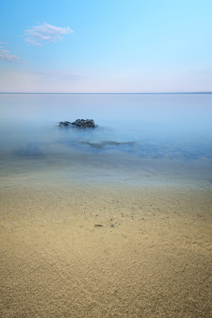 stones in the water at slow shutter speeds, overcast evening time Stock Photo
