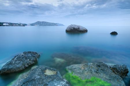 stones in water  bright evening photo summer Crimea Stock Photo