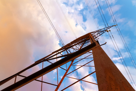 the old line of electric transmission  vivid evening the picture on the background of the colorful sky
