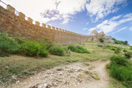 sudak: wall of ancient fortress  bright summer landscape travel Crimea Stock Photo