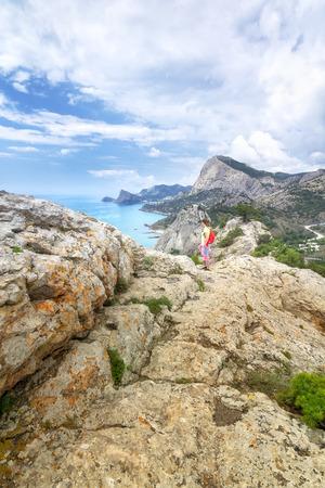 Woman on a rock  hiking tour of Crimea Stock Photo
