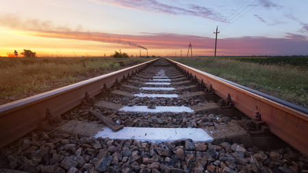 Railway in the steppe  photo right after sunset road leading to the distance Stock fotó