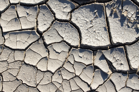 drought makes the ground interesting things  texture of cracked earth close-up 스톡 콘텐츠