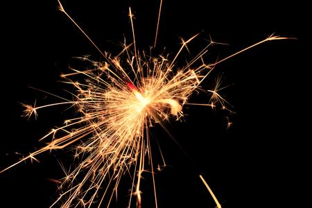 Bengal fire fireworks on black background / sparkling fireworks on black macro background