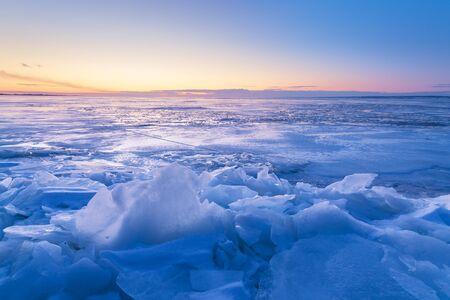 misty dawn on a frozen river  sun breaks through morning fine snow Banco de Imagens