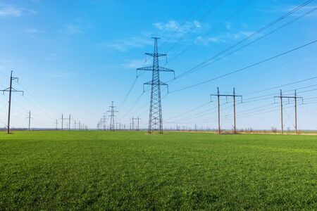 powerline against the background of natural beauty / a vivid example of energy in nature