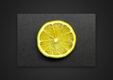 lemon on a grey background / Passepartout background photo 版權商用圖片