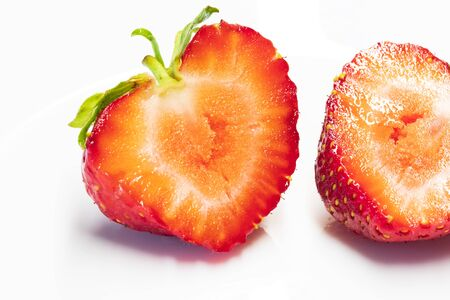 strawberry close-up / on a white plate background