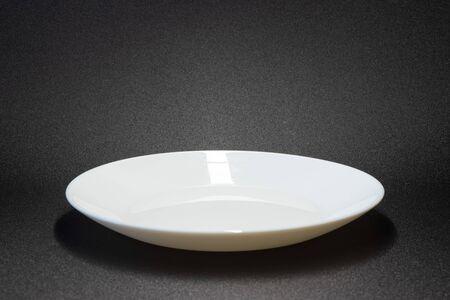 plate on a grey background / empty plate background photo 版權商用圖片