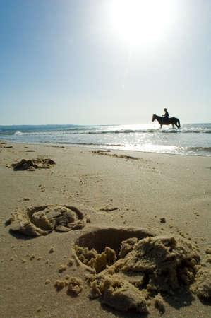 walk on horseback on the beach Stock Photo