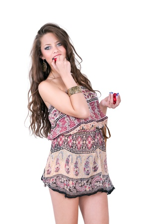 Atractive young girl in dress with cherry over isolated background photo