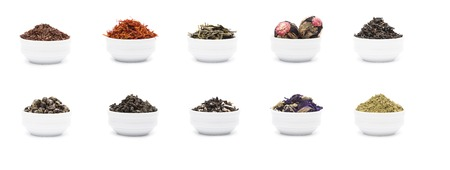 gunpowder tea: Set of dry tea leaves in white porcelain bowls, isolated on white with shadow