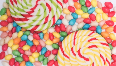 bonbons: Candy background with big lolipops and bonbons Stock Photo