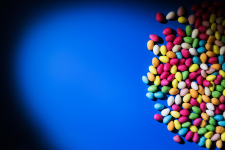 bonbons: Big lolipops, bonbons and marshmallow on blue background