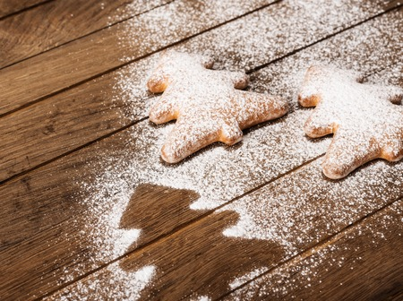 Cookies in shape of christmas tree on wooden background